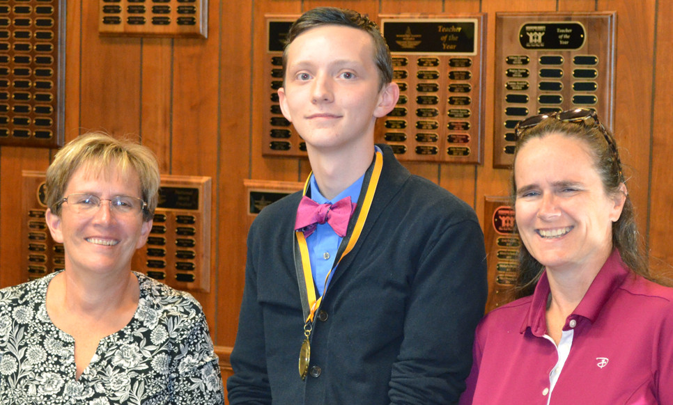 CHARLES ADAMS, a participant in the Governor's School for the Arts program this summer, is pictured with board members Karen Brock, left, and Sherri Springate, right. Also GSA participants, but unable to attend Monday night's board meeting, were Nicholas Adkins and Hannah Iglehart. (Photo by Bob Vlach)