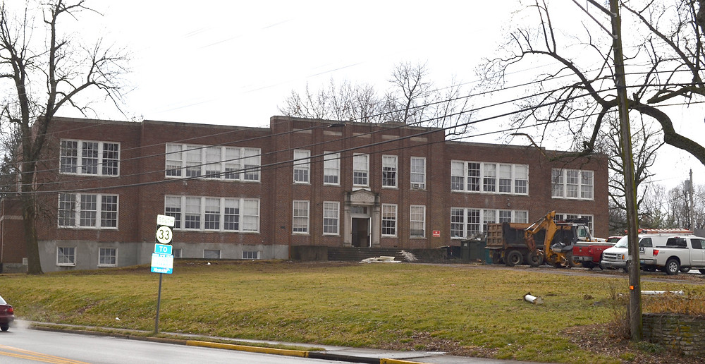 A FORMER SCHOOL BUILDING will soon provide affordable housing for 13 families in Versailles. The Woodford County Board of Education sold the aging school building at 299 South Main Street (most recently occupied by the Community Education Center) to AU Associates last year for $74,000. (Photo by Bob Vlach)