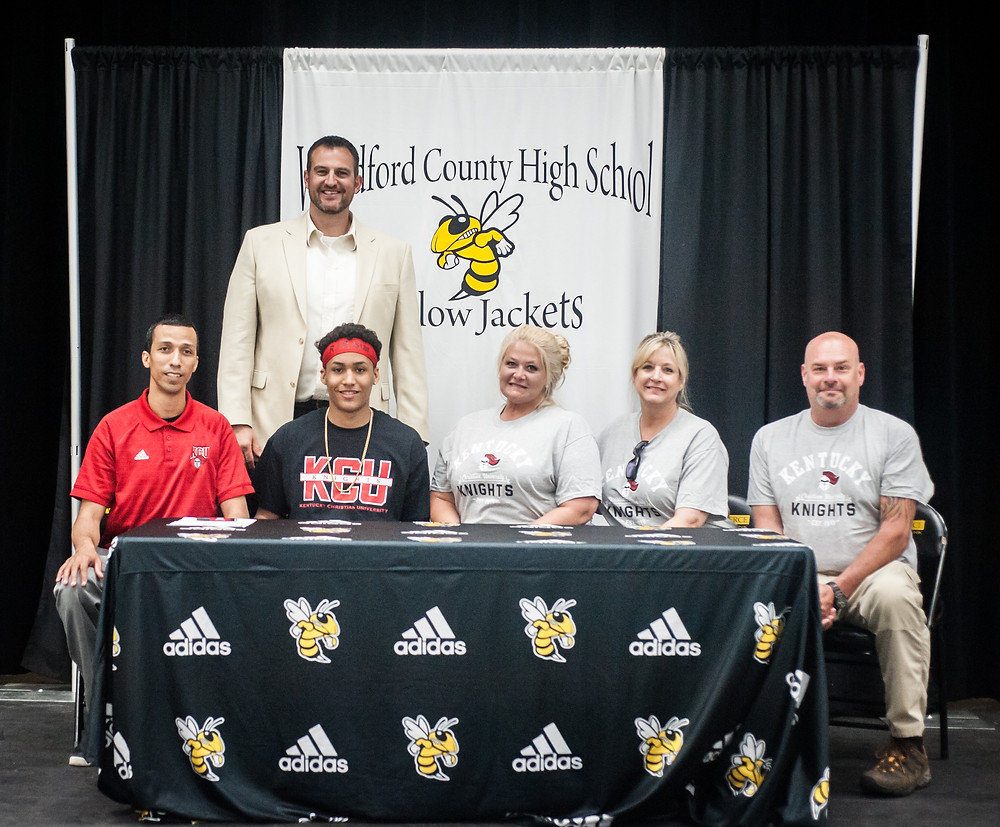 WCHS SENIOR NICK SMITH signed his letter of intent with Kentucky Christian University on Wednesday, May 2. Pictured from left, front row: KCU Coach Akeem Scott, Nick, mother Kelly Shell, aunt Ronda Juett and uncle Tim Juett, back row: WCHS Coach Ryan Wilson. (Photo by Bill Caine)
