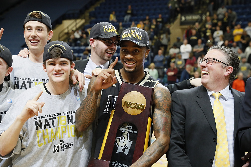 VERSAILLES NATIVE DALE WELLMAN,right, celebrates the NCAA Division III national championship with his players on Saturday, March 17. Hours before winning the national championship, Wellman was named the NCAA Division III coach of the year. (Nebraska Wesleyan University athletics photo)