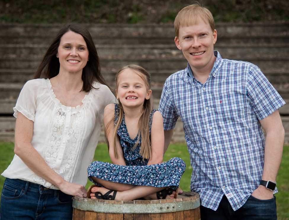 TIFFANY MARSH, a vocal music teacher at Paul Laurence Dunbar in Lexington and a resident of Midway, was named 2019 Kentucky High School Teacher of the Year. Marsh is pictured with her husband, Ryan, and their 6-year-old daughter, Emory, a student at Northside Elementary School. (Courtney Paris Photography)