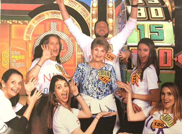 """DEBRA MILLER, a resident of Versailles, pictured at far left, joined a group of friends – all flight attendants with Southwest Airlines, plus a nanny named Lori Ramsey – in the studio of """"The Price Is Right"""" in February for a taping of the game show. Woodford County viewers will have to wait until tomorrow (Friday) morning to see if Miller or any of her friends (Allan Lannoy, Jane  Usry, Lynsey Stevens, Falan Lannoy, Andrea Taylor and Ramsey) were told to """"Come on Down."""" (Photo submitted)"""