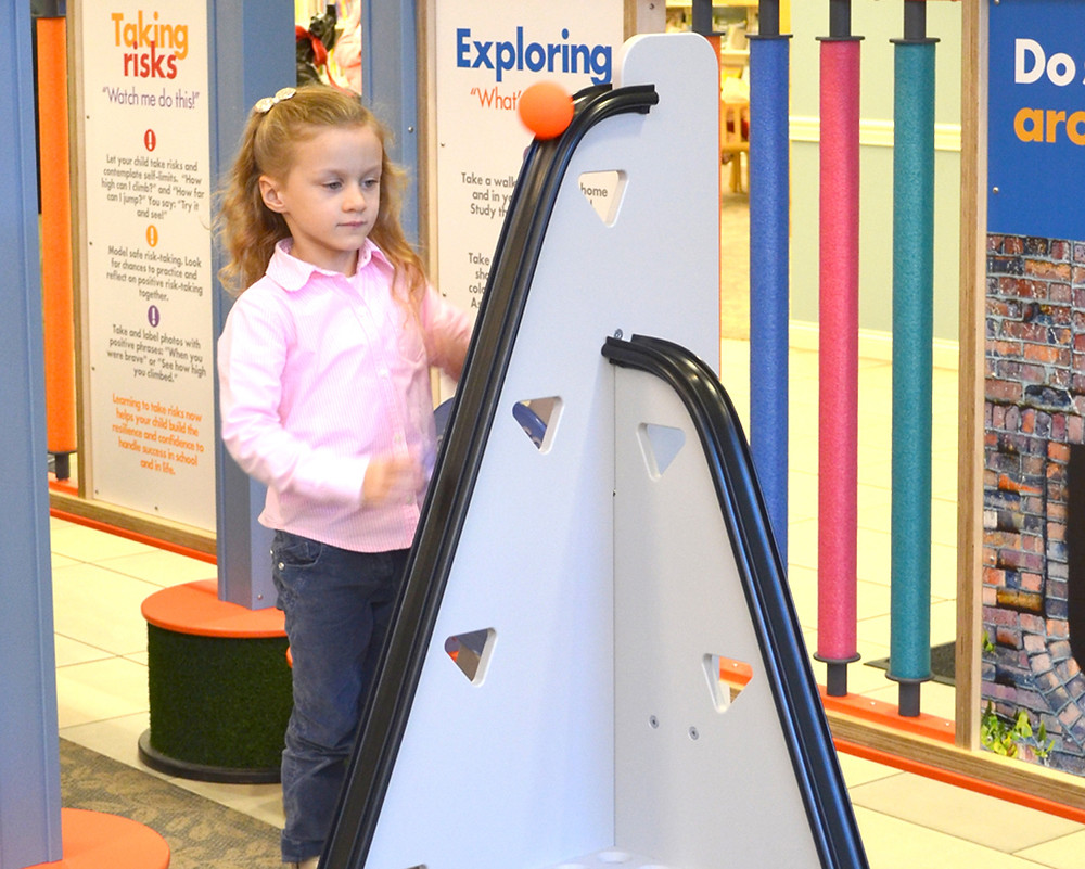 """ZOE PANTALEON, 5, got to experience how gravity works while visiting Science in Play 2GO at the Woodford County Library in December. Last Thursday, Feb. 2, assistant youth services librarian Bookie Wilson said 72 children were engaged in Science in Play2Go hands-on activities before noon. """"So the numbers have been exceptional. We've been really pleased,"""" Wilson said. (Photo by Bob Vlach)"""