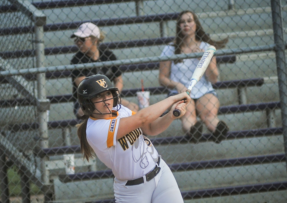 WCHS SENIOR BAILEE RAMNES watches a fly ball to right field in the Lady Jackets 15-1 district win over Frankfort on May 21. (Photo by Bill Caine)