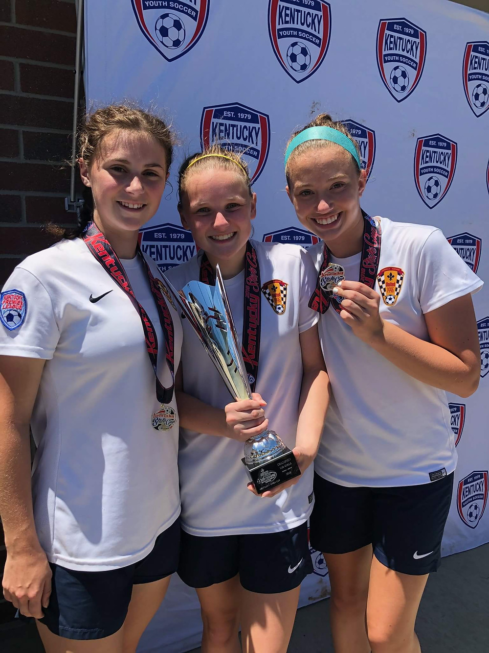 WCHS SOPHOMORES, Reagan Gilbert, Mackenzie Tucker and Emma Oberlander won the State Cup playing for their club team, United 1996 FC. The trio will travel to regionals June 22. (Photo submitted)
