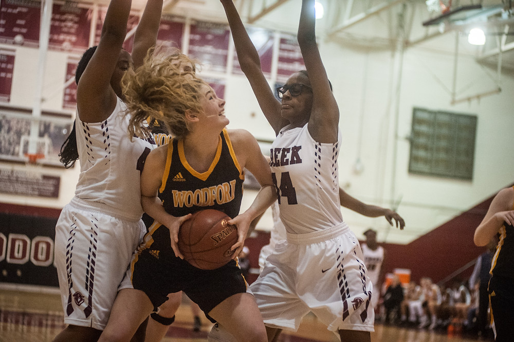 WCHS JUNIOR NIA JACO battles for position under the basket in the Lady Jackets' win over Tates Creek on Jan. 4. (Photo by Bill Caine)