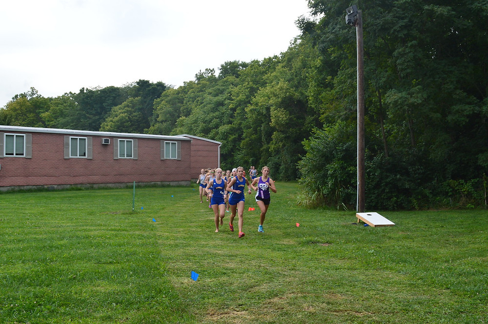 MIDWAY UNIVERSITY RUNNERS Philippa Asherwood (left) and Emily Chandler (center) lead the pack at Ohio Christian University Invitational Aug. 24. (Midway Athletics photo)