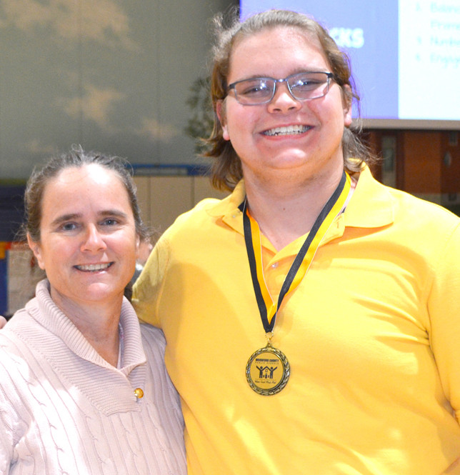 WCHS SENIOR Connor Akers, recognized by the Woodford County Board of Education for being named a National Merit Scholarship semifinalist, is pictured, with board member Sherri Springate. (Photo by Bob Vlach)