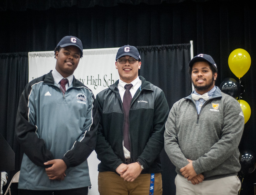 THREE WCHS FOOTBALL PLAYERS signed with Campbellsville University on Feb. 7 in a ceremony held   in the WCHS cafeteria. All three signees were lineman for the Jackets this past season. From left: Jayden Hamilton, Omar Renteria and Jaylan Washington. (Photo by Bill Caine)