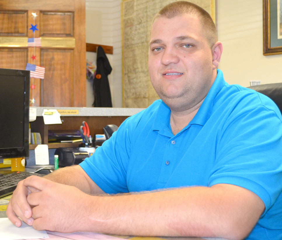 """JIMMY CHAMBERS, new operations manager and environmental education coordinator for the Woodford County Conservation District, described the folks who wander through his office as """"some of the best people in Woodford County."""" (Photo by Bob Vlach)"""
