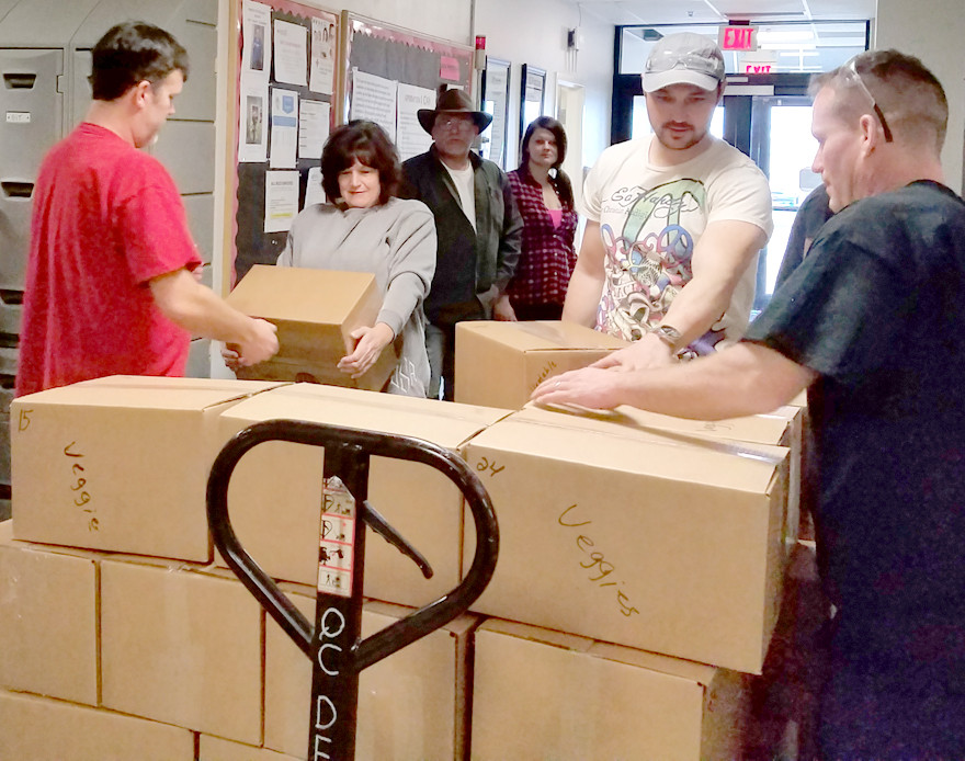 EMPLOYEES AT YOKOHAMA loaded a pallet with canned goods that were donated to a church in Hazard, where about 250 boxes of food are given to needy families twice a month (Photo submitted)