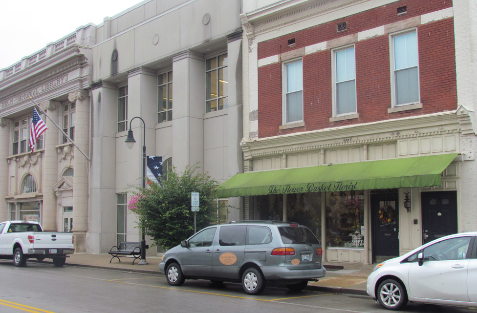 THE BUILDING HOUSING The Flower Basket Florist shop at 131 North Main Street, right, could be demolished early next year to make room for an addition to the Woodford County Public Library. The $3 million plan still has hurdles to clear, however. (Photo by John McGary)