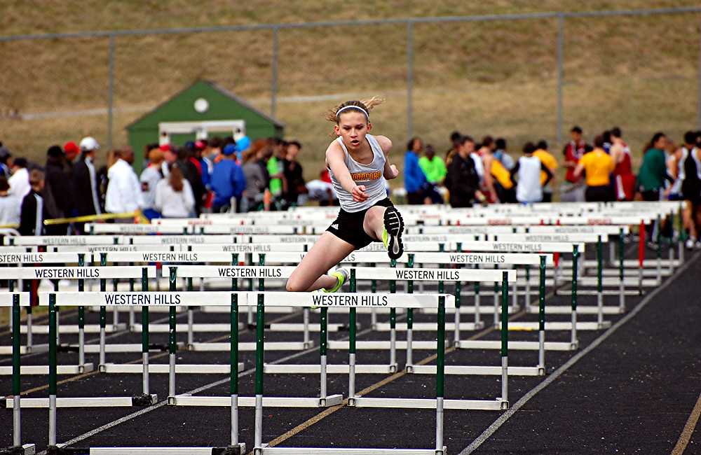 JORDAN CROWE returns this year to run the hurdle events for the Woodford County High School girls' track team. The track teams open their season at home this Saturday, March 19, in the Luck 'O the Irish meet. (File photo by Rick Capone)