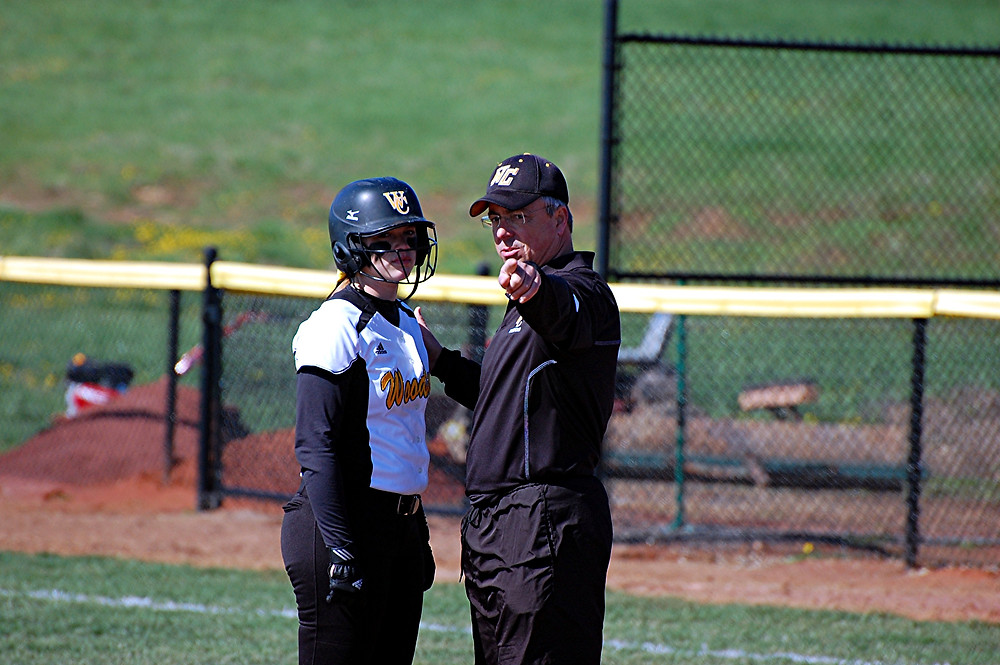 LES ANDERSON talks strategy with a Woodford County High School player during a game last year. Anderson was named the new head coach of the Lady Jackets on Tuesday, July 19. He replaces Sasha Turansky, who was head coach for the last four years. (File photo by Rick Capone)