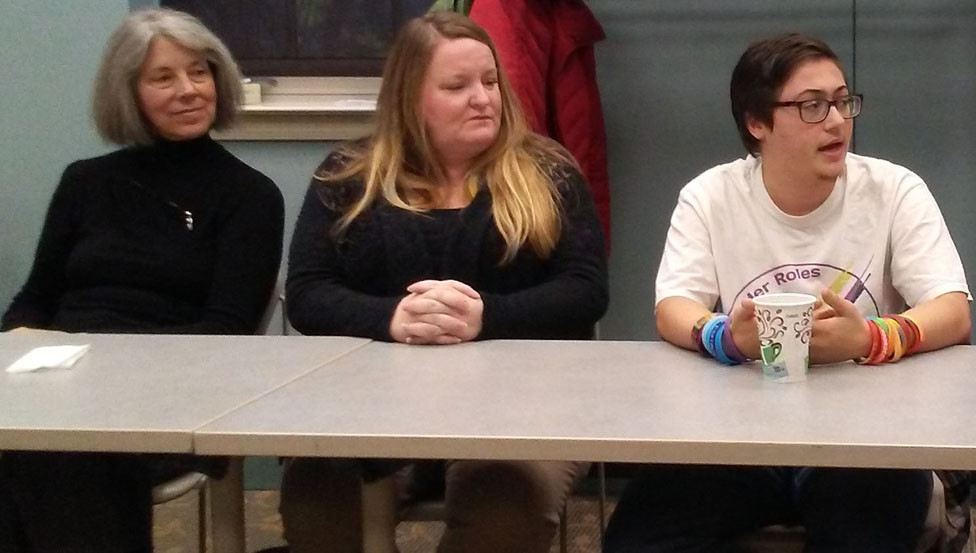 """ISAAC BATTS, on the right, self-described as """"agender,"""" is a 2015 WCHS graduate who was one of six panelists for a discussion of transgender issues Sunday at the Woodford County Public Library. Batts was one of the people who publicly spoke in favor of the Fairness Ordinance passed by the Midway City Council in 2015.  From left, Beth Scherfee, Kathleen Pezzi, and Batts. (Photo by John McGary)"""