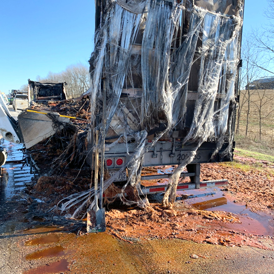 BOTH LANES OF EASTBOUND I-64 were shut down intermittently Sunday morning beginning at around 11:30 while Woodford County firefighters put out a fire involving a commercial truck hauling food products, Woodford County Emergency Management Director Drew Chandler said. He said water runoff resulted in food products contaminating some of the nearby soil. (Woodford County Emergency Management photo)