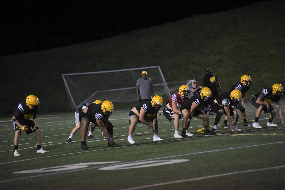 THE WCHS FOOTBALL TEAM began practice with pads on Tuesday, July 24.  Regular season play begins in two weeks. (Photo by Bill Caine)