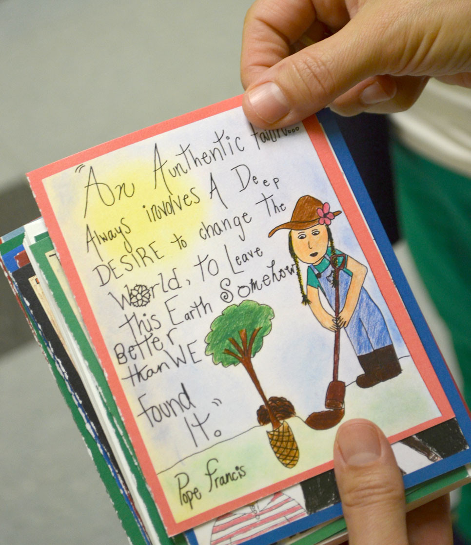 CARDS, like the one pictured, include a quote from Pope Francis and art created by students at St. Leo School. Proceeds from the sales of the cards will help refugee families in the Catholic Diocese of Lexington. (Photo by Bob Vlach)