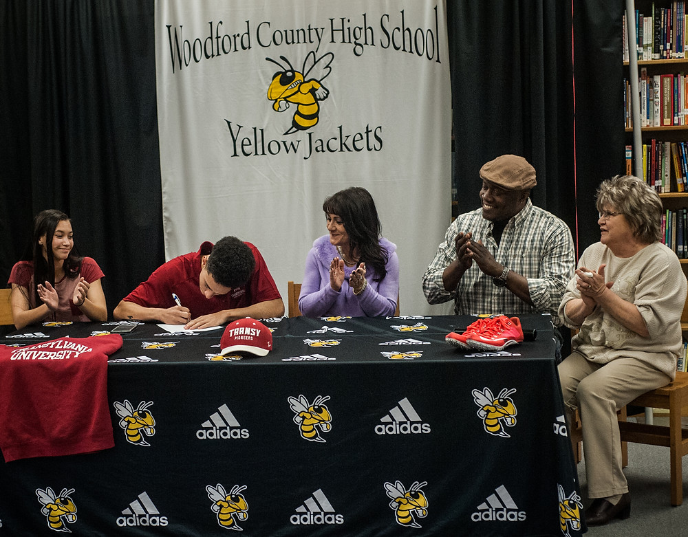 JORDAN UPTON signed his letter of intent to join the track and field program at Transylvania University on Jan. 24. Pictured from left: Jordan's sister, Raven Upton, Jordan, family friend Tony Bryant ,Jordan's mother Deneilya Upton, and grandmother, Judy Beckley. (Photo by Bill Caine)