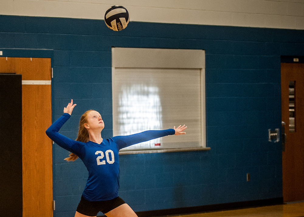 ELLA OBERLANDER delivers a serve in the second set against Mary Queen. (Photo by Bill Caine)