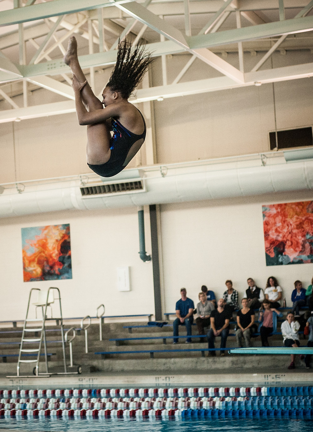 SENIOR CHELSEA CALL performs a dive during a dual meet with Lexington Catholic High School on Wednesday, Nov. 29 at Falling Springs. (Photo by Bill Caine)