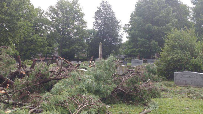 MIDWAY CEMETERY was hit hard by the July 20 storms, but five days later, 30 volunteers helped clean it up, likely saving city workers dozens of additional hours of overtime. (Photo by Sarah Strohl)