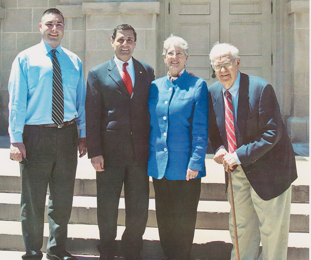 """MARK GORMLEY is pictured in front of the Woodford County Courthouse several years ago with, from left, Terrell Renfro, former Kentucky Lt. Gov. Daniel Mongiardo and Toni Curtis, wife of well-known Versailles photographer Jim Curtis. Gormley concluded his tenure as Woodford County attorney in 1993, realizing it he was """"ready to call it quits"""" with major changes coming to that elected office. (Photo submitted)"""