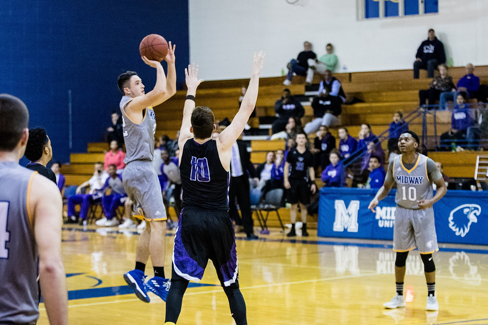 WILL HUDSON, a sophomore from Calhoun, Ky., hits the game-winning three at the buzzer to give Midway the 77-76  victory over Cincinnati Christian University. (Photo by Mark Mahan)
