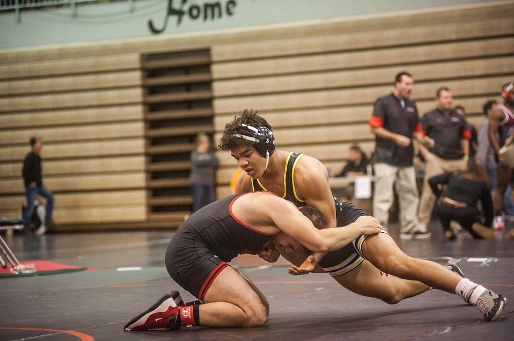 WCHS SOPHOMORE TRISTON BROOKS,right, photographed at the Raider rumble on Dec. 9, is one of the many athletes having a great season for the Mat Jackets. (Photo by Bill Caine)