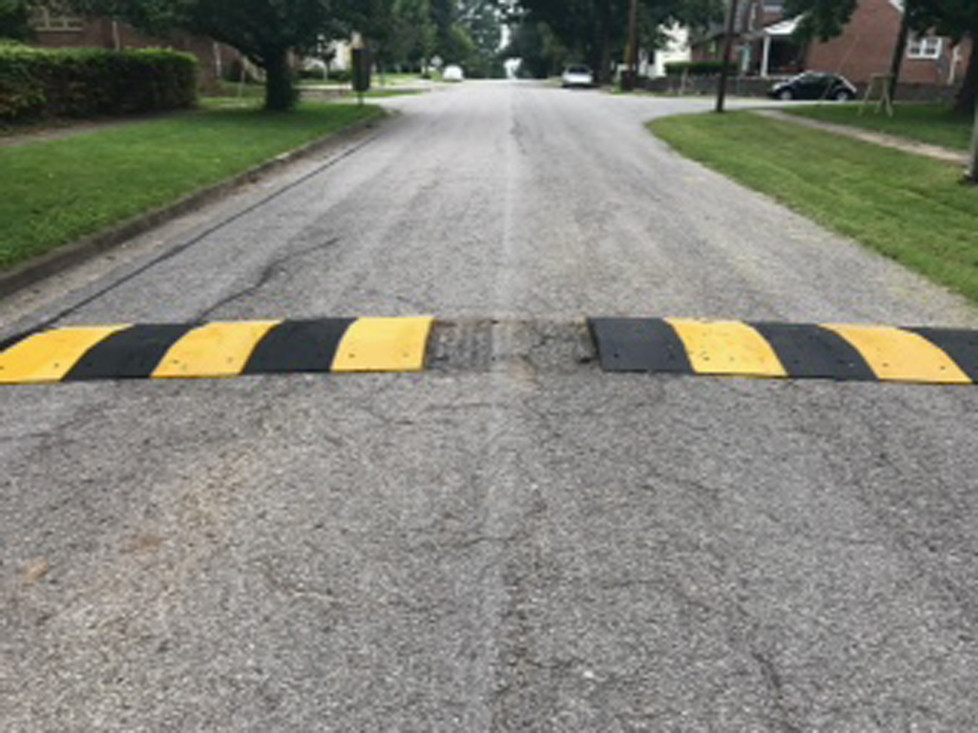 MIDWAY'S SPEED BUMPS were removed last week after they began deteriorating and coming loose from the pavement on East Stephens Street. Mayor Grayson Vandegrift said he expected to get a refund from the manufacturer for the $5,300 bumps, which were installed in May. (Photo by John McGary)