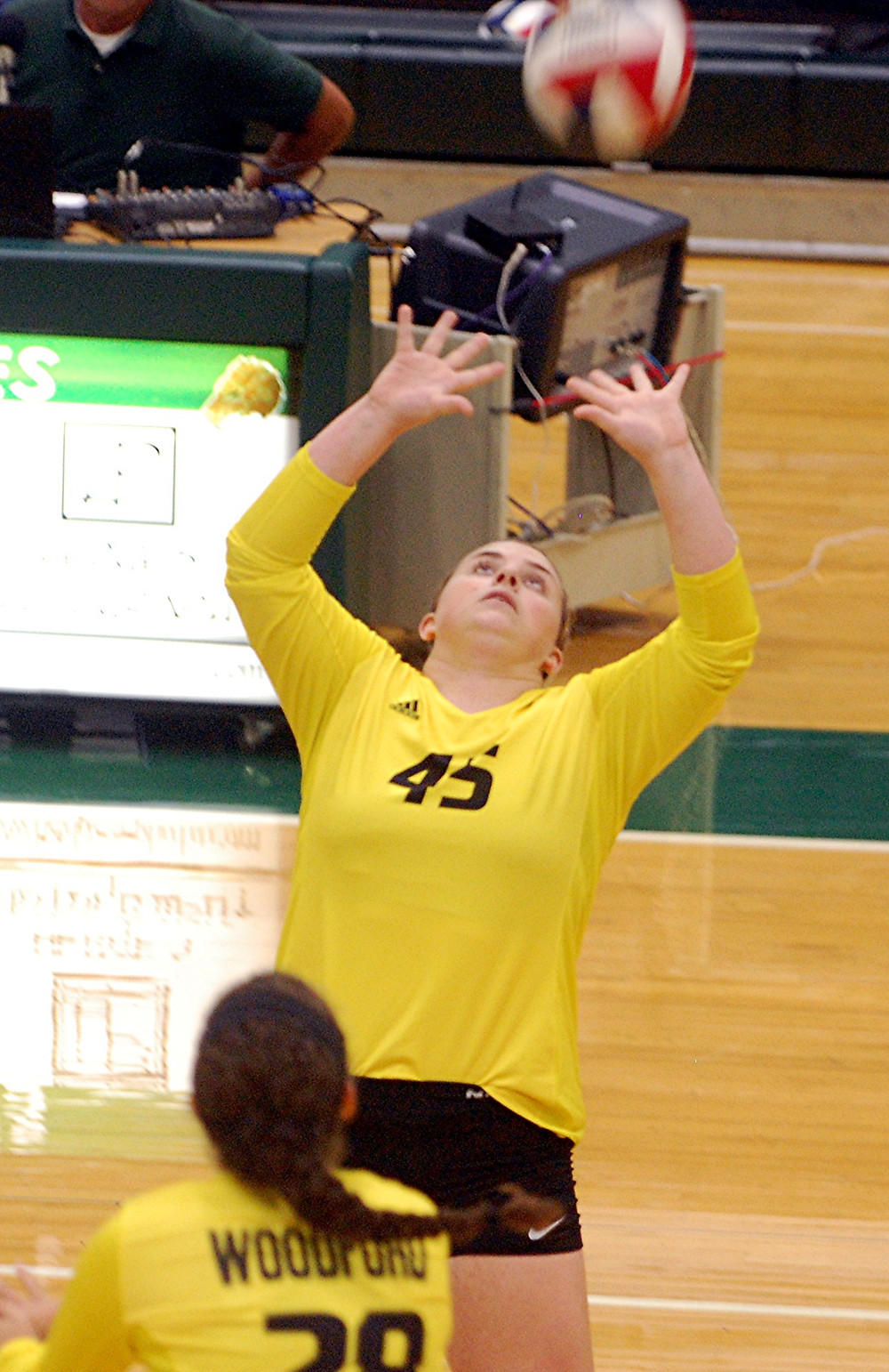 """The Woodford County High School volleyball team might be young """"on paper,"""" but they played like veteran  upperclassman as they overcame a season-ending injury to a key player, senior Morgan Kennedy, but then dug down, regained momentum and scored an exciting 3-2 (25-23, 25-23, 19-25, 20-25, 15-10) road win over district rival Western Hills on Thursday, Aug. 18.  With that win, and their 2-1 (25-18, 20-25, 25-22) season opening road win over Marion County on Tuesday, Aug. 16, Woodford is now 2-0 this season.  """"Overall, I was pleased with how we played in our season opener against Marion County,"""" said third-year Woodford head coach Megan Bottom. """"We came out with a lot of focus, energy, and aggression early on. While these components ebbed and flowed during the match, the team learned the importance of having consistency in all three of these areas in order to be successful.""""  While the win over Marion County was a good way to start the season, the win over Western Hills, a district rival, especially on the road, is even more important as the Lady Jackets now have confidence in their playing abilities after such a strong comeback win to start the year off.   """"They came out and they were ready to play (against Western Hills),"""" said Bottom. """"They were ready to win. We talked about working hard in practice and fighting. The 12 of them versus everybody else. And, they came out with that mentality.   """"Then, when Kennedy went down, they had to rally back around her. They kind of got into a lull, which is no excuse. They still need to be able to push through. But, they were able to recover and finish out to get the win.""""  The first two games were tight ones from start to finish. In the first game there were seven ties and five lead changes, and at one point near the end of the first game, Woodford was down by five points twice.  In the game, Western Hills opened an early 3-1 lead, but Woodford came back to tie it 5-5. The teams continued to battle, tying 6-6, 7-7, and 10-10."""