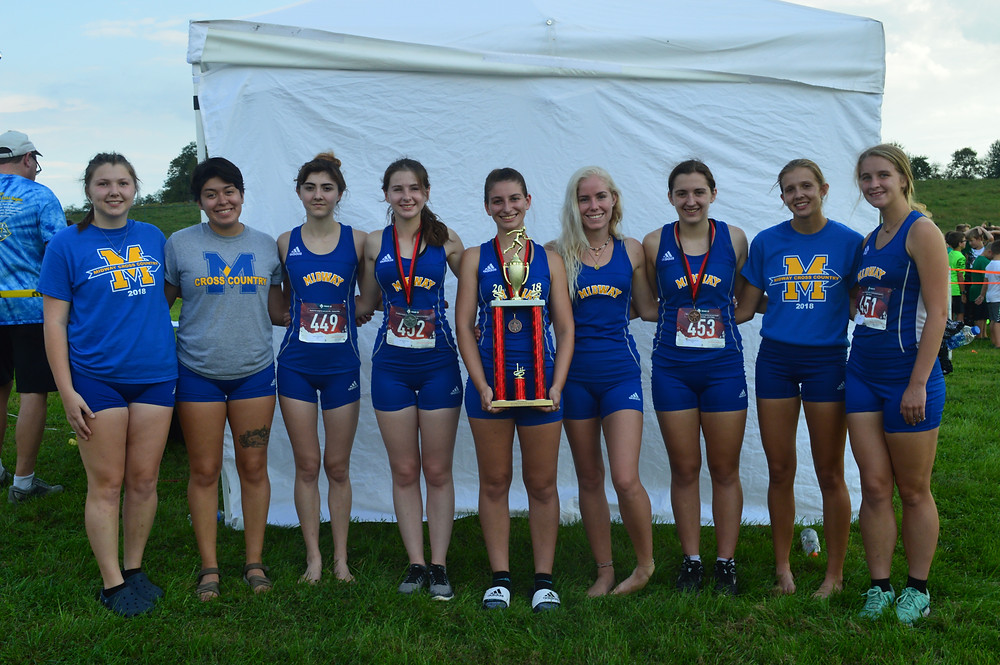 MIDWAY UNIVERSITY'S WOMENS' CROSS COUNTRY TEAM poses with first place trophy. From left to right are Cassie Fryman, Nataly Gonzalez, Josette Isaacs, Julia Sammet, Rachelle Felski, Philippa Asherwood, Madeline Segars, Emily Chandler, and Ann Oakley. (Midway University Athletics photo)