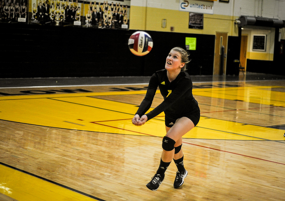 LAUREN SMILEY chases down a ball in the third set against Madison Central on Tuesday night. (Photo by Bill Caine)
