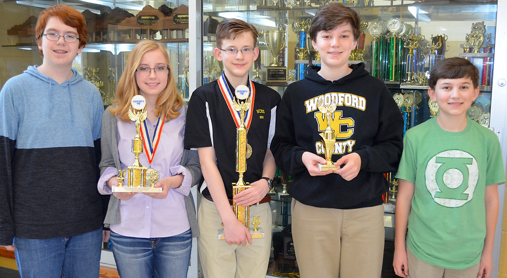 Cutline: BEN HUMPHRIES, pictured in middle, an eighth-grader at Woodford County Middle School, finished first in arts and humanities at the 2016 Kentucky Governor's Cup state finals in Louisville. Overall, WCMS finished 11th in the state. Pictured, from left, are Derek Forte, who finished 56th out of 130 students in math; Ashlyn Martin, who finished fifth in arts and humanities; Ben, a state champion; Logan Craig, who scored higher than any other Kentucky middle school student taking the inaugural general knowledge test; and Bryant Craig, who finished 32nd among 130 students in science as a sixth-grader. (Photo by Bob Vlach)