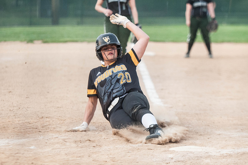JOCELYNN EDWARDS slides into home plate in the top of the sixth inning to make it 7-1 against Western Hills on April 17. Edwards was a courtesy runner for Kelsey Coleman. The Lady Jackets went on to win 11-1.