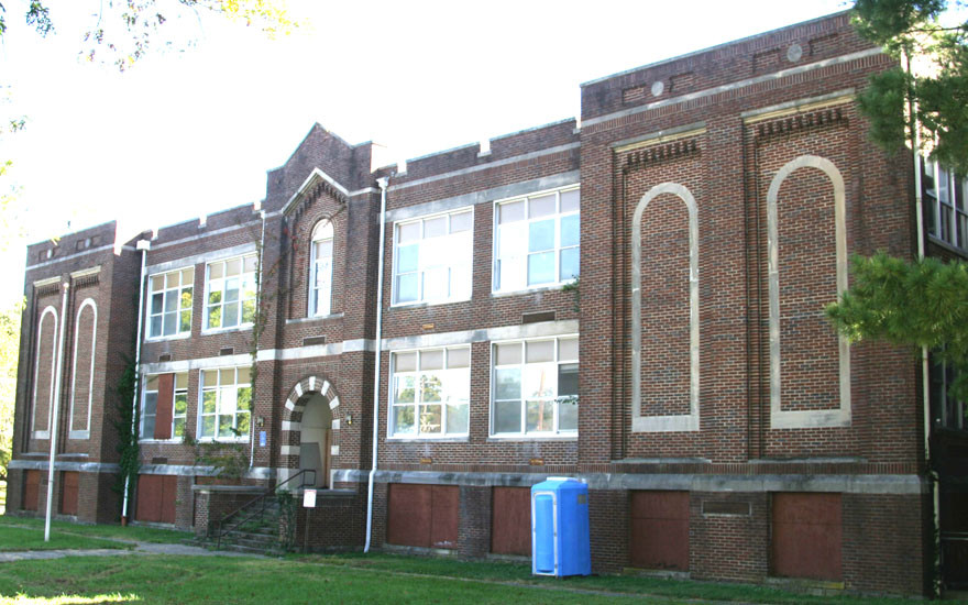 """THE """"OLD MIDDLE SCHOOL,"""" as the building on the corner of Lexington and Maple streets is usually referred to, could be demolished. However, efforts by local officials and citizens to save the 90-year-old building are underway. (Photo by John McGary)"""