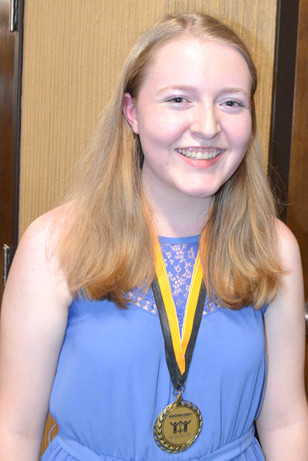 JENSEN McMURRY won first place at the Kentucky FFA State Convention in June. She and Caryl Lynn Akers, not pictured, who also won a first place award at the state FFA Convection, were recognized by the Woodford County Board of Education Monday, Aug. 27. (Photo by Bob Vlach)