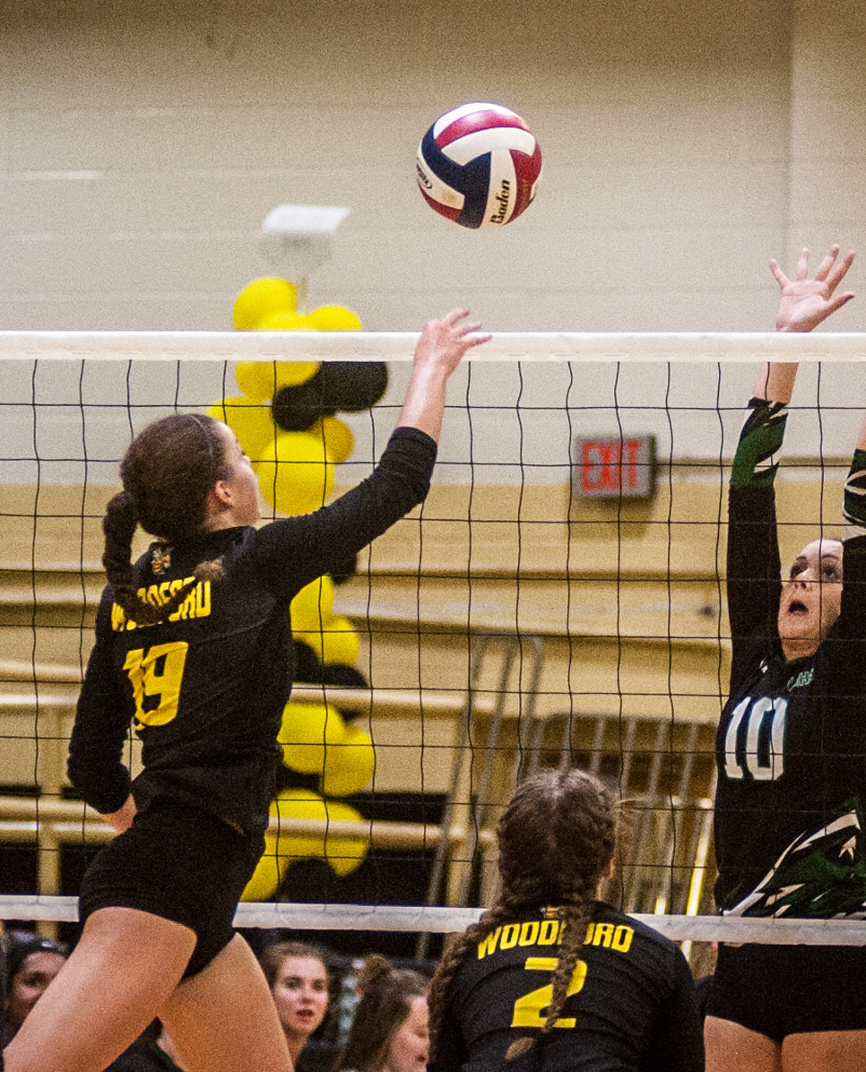 GEORGIA SUTTERLIN sends a ball over two Western Hills defenders in the final set. (Photo by Bill Caine)