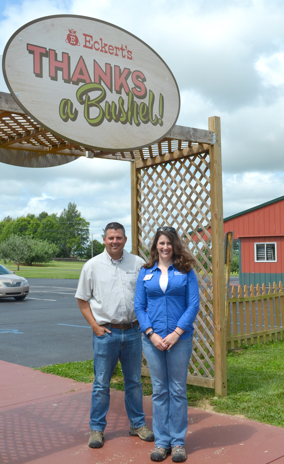 """CHRIS ECKERT and Megan Fields, the general manager of Eckert's Boyd Orchard, said some changes are planned for the agri-business, formerly owned by Terry and Susie Boyd. """"Our guests have come in and enjoyed seeing the changes in the market,"""" said Fields. """"...They're excited about pick-your-own peaches ... something new that we're doing now."""" (Photo by Bob Vlach)"""