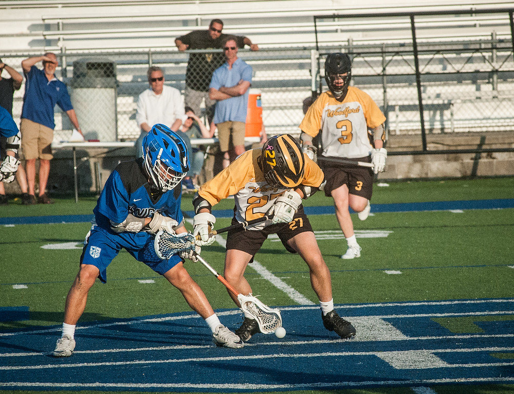 WCHS SENIOR BEN DAWSON battles with a Lexington Catholic midfielder in the Jackets' state semifinal loss on Thursday, May 10. (Photo by Bill Caine)