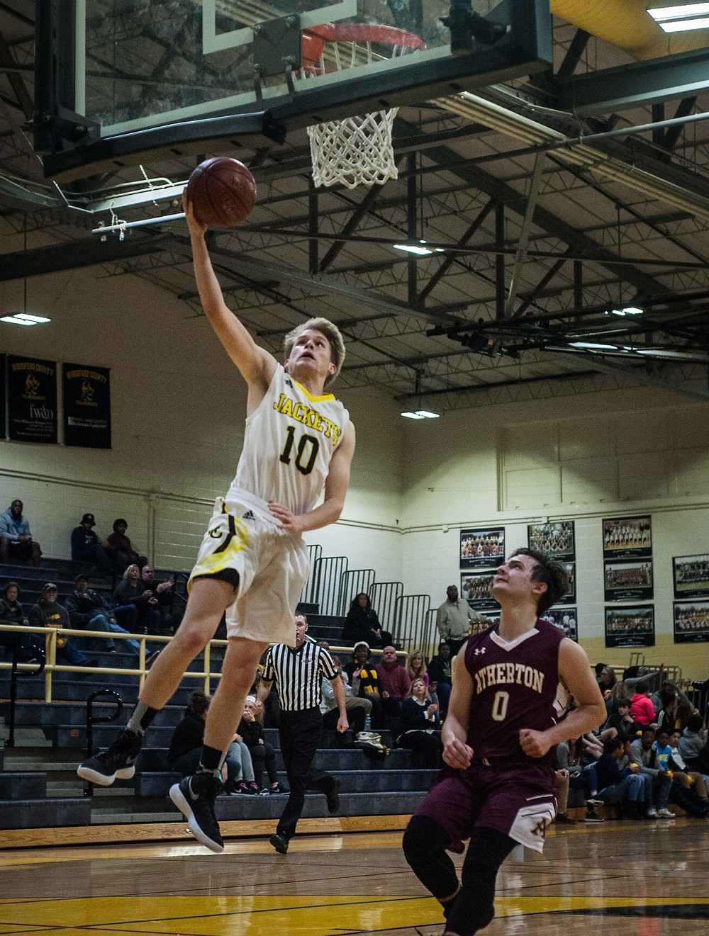 WCHS JUNIOR RYAN DUKE scores a layup in the  Jackets win over Atherton on Tuesday, Dec. 19. (Photo by Bill Caine)