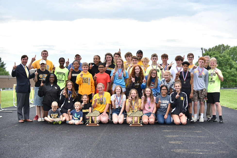 THE WCMS TRACK AND FIELD STATE CHAMPIONSHIP TEAM was celebrated by friends and family at an event at the high school Tuesday, June 8. (Photo by Bill Caine)