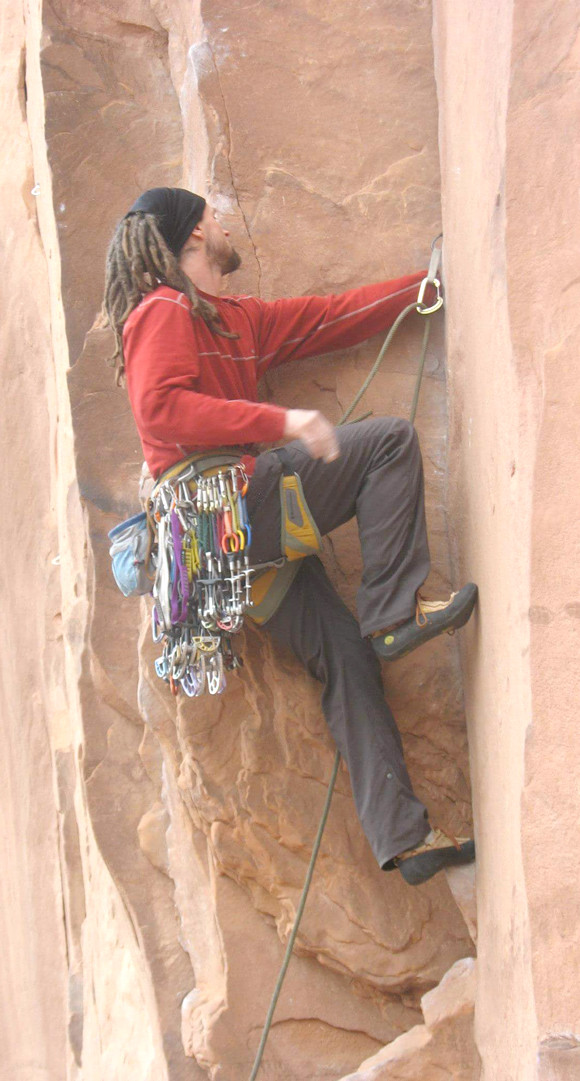 KENNETH JOHNS climbs a vertical wall at Indian Creek in Mohab, Utah. Indian Creek was his favorite rock climbing experience because it offers the type of traditional climbing he prefers. (Photo submitted)