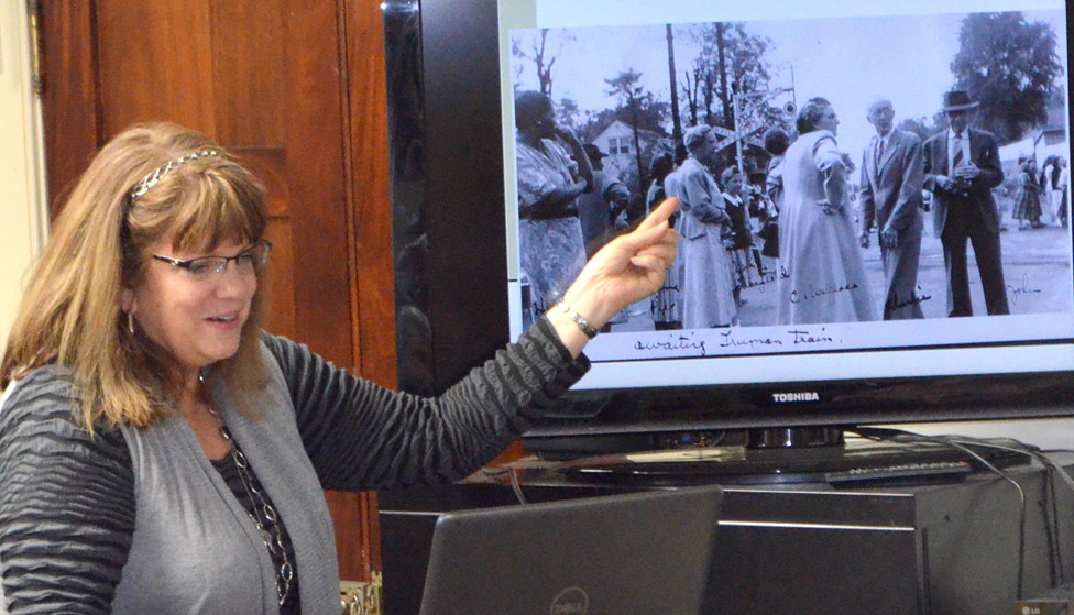 """""""REFLECTIONS OF MIDWAY: 1832 to Holly Hill Inn"""" was an opportunity for Amy Rouse Perry to share her family's story during a special program at the Woodford County Historical Society on Jan. 25. Perry and her daughter have scanned over 1,000 photos and documents to tell their family's story, she said. And she urged those attending the program to """"write your stuff down. Put your information on the back of pictures."""" (Photo by Bob Vlach)"""