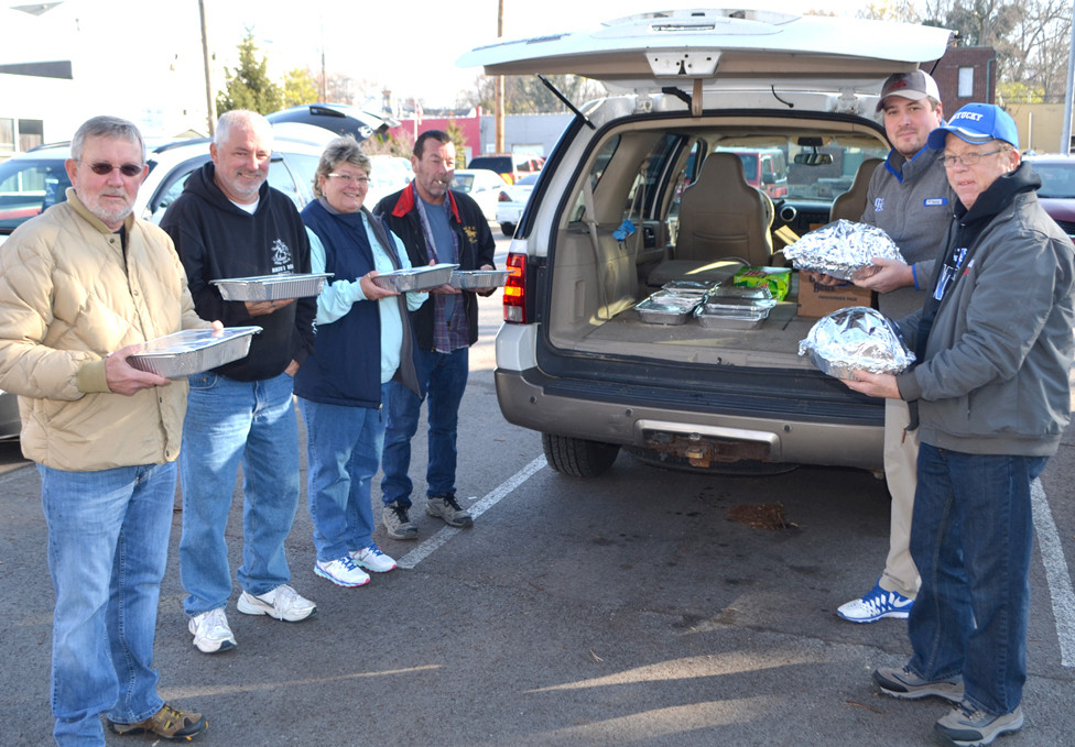 SONS OF THE AMERICAN LEGION Post 67 delivered Thanksgiving dinners to six less fortunate families in Versailles last Wednesday, Nov. 22. From left are Tom Vanderpool, Jack Roe, Debbie Brumback, Marty Coomer, Josh Rodgers (president) and Joe Routt (vice president). (Photo by Bob Vlach)
