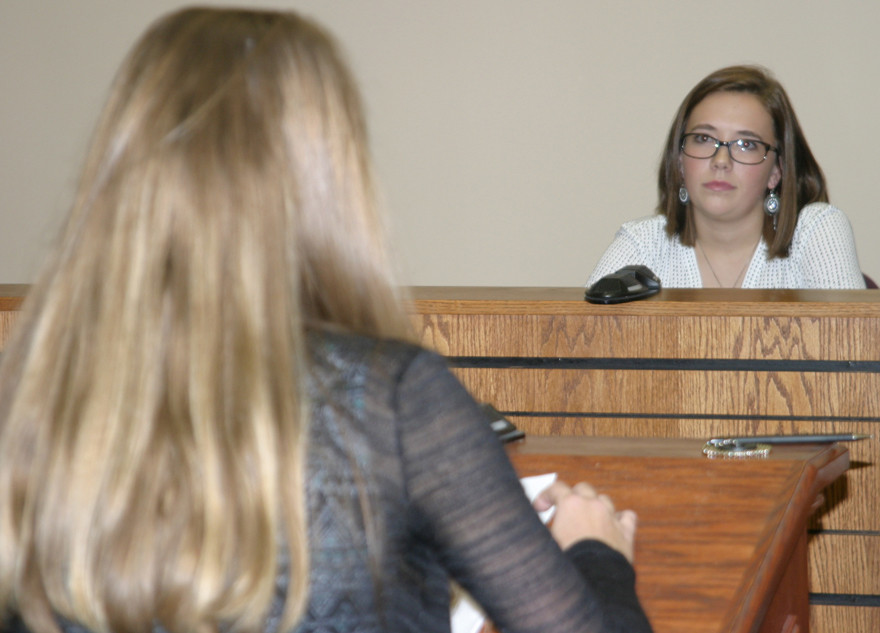 DEFENDANT SYRENA SHARLOW, playing a boy accused of fourth degree assault on a student and teacher, was questioned about the events of that day by prosecutor Ava Crawford. Some of the graduates of Woodford Teen Court will serve in real Teen Court proceedings. (Photo by John McGary)