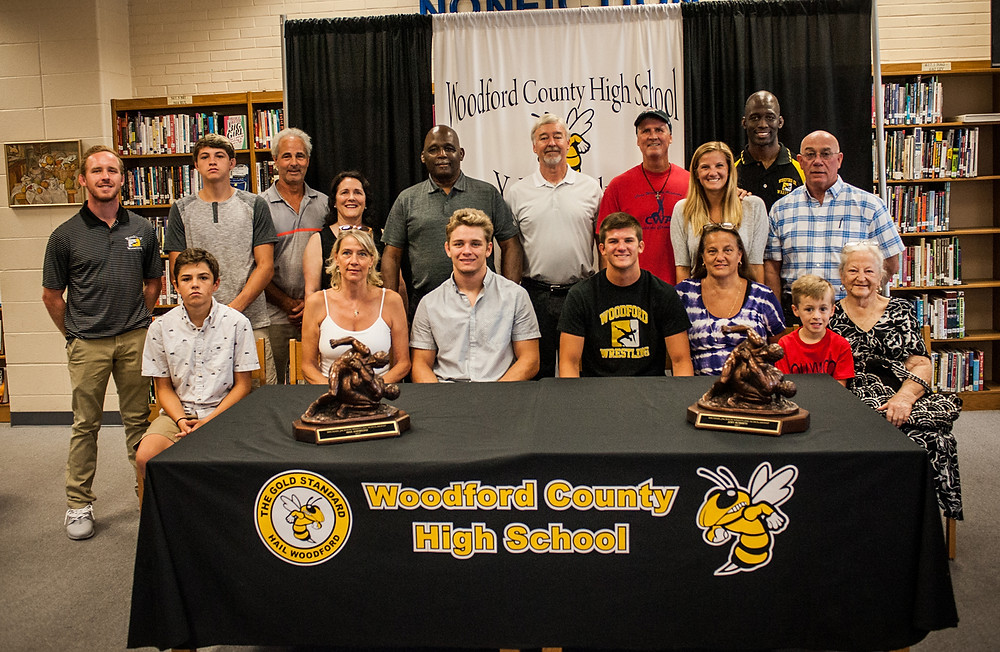 MAX ANDREONI AND JOEY ROBERTS were awarded the Michael Jackson Wrestling Scholarship July 18 at Woodford County High School. The winners are pictured with the board and attending family members. Front, from left, are Gavin Andreoni, Becky Andreoni, Max Andreoni, Joey Roberts, Toni Roberts, Jonathan Roberts, and Betty Galvan; back row, wrestling coach Rusty Parks Jr., Wyatt Andreoni, Mike Andreoni, Debbie Jackson, Joe Carr Sr., Rusty Parks, Tim Roberts, Janina Roberts, Joe Carr Jr., and Randy Cotton. (Photo by Bill Caine)