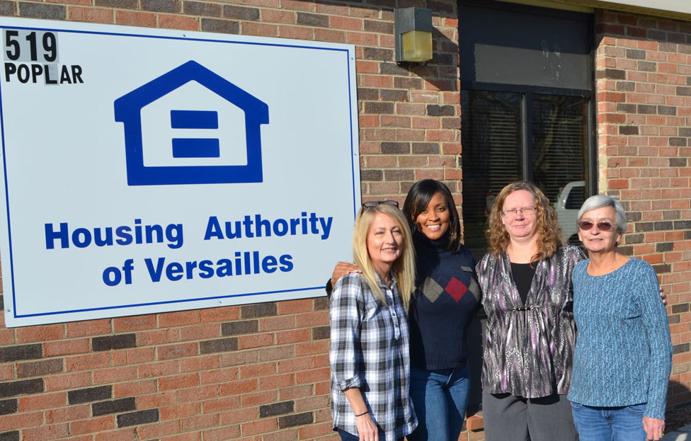 THE HOUSING AUTHORITY of Versailles provides low-income families with affordable housing opportunities with the goal of transitioning those families to self-sufficiency and home ownership, said Executive Director Chantel Bingham. From left are Housing Authority office assistant Kelly Jo Chamness, Bingham, occupancy specialist Jennifer Umbel and administrative assistant Linda Foley. Not pictured are maintenance workers Gaylord Montague, Wayne Johnson and Bob Stromberg. (Photo by Bob Vlach)