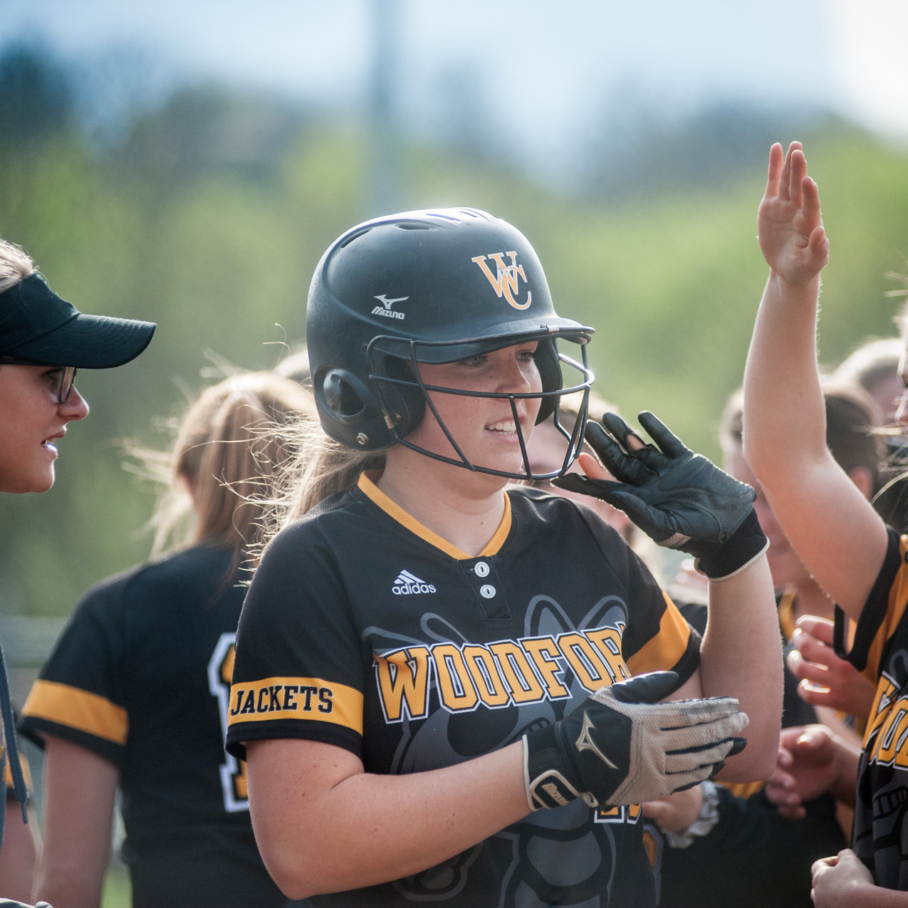 WCHS SOPHOMORE ABBY MOFFETT high-fives teammates after hitting a two-run home run in the Lady Jackets mercy rule win against Frankfort on Wednesday, April 25.  (Photo by Bill Caine)