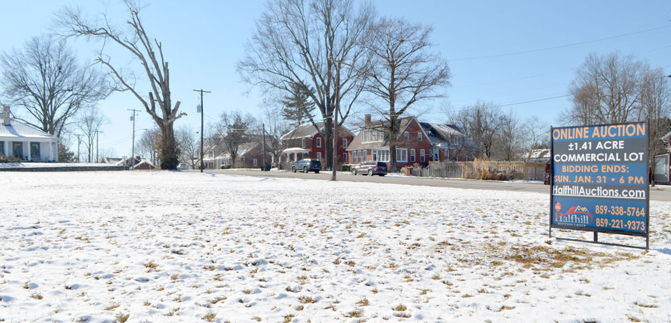 """A VACANT LOT, formerly occupied by Woodford County Middle School, was sold at auction for $400,000 Jan. 31. New owner Tim Cambron said he doesn't have concrete plans for how he'll use the lot at the corner of Maple and Lexington streets. """"I just thought it was a good location …,"""" he said. (Photo by Bob Vlach)"""
